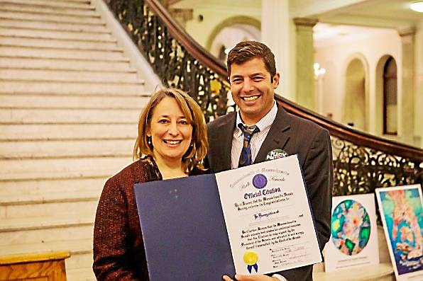 Courtesy photo Emerson College professor, Brad Verter, right, of Williamstown receives a citation from state Rep. Lori Ehrlich, D-Marblehead, at the State House on Thursday, where he was honored for his work helping to pass bills banning single-use plastic bags, bottles and polystyrene.
